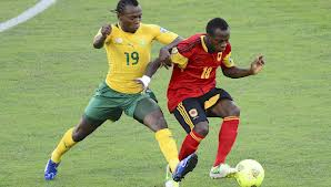 May Mahlangu battling for the ball against Angolan player. Picture by Kick Off