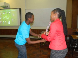 Maud Blose receiving a box of chocolate from a student. Picture by: Qiniso Mbili