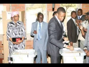 Mugabe's son Rorbert Mugabe Junior castes his vote for the first time as his parents stand behind him in support.