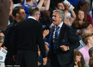 Anger: A furious Jose Mourinho screams at Paul Lambert on the touchline.  Pictures from Getty Images.