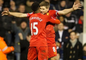 Daniel Sturridge is congratulated by Liverpool captain Steven Gerrard after scoring against Swansea on Sunday. Pictures by Liverpool.com