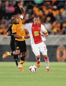 Simphiwe Tshabalala battling against his former team mate Dominic Isaacs in the PSL encounter. Pictures by Kickoff.com