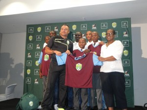 AmaZulu coach Craig Roslee handing over the kit to Lamontville High School pupils at the Moses Mabhida Stadium yesterday. Pictures by Siyabonga Ngcobo