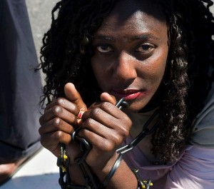 A woman sitting outside parliament in South Africa demonstrating against human trafficking.  Picture by: