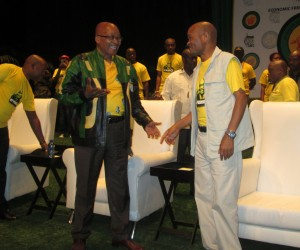 President Jacob Zuma shares a joke with KZN Premier Senzo Mchunu. during the OR Tambo lecture in Durban.
