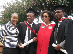 Maud Blose, Sphelele Ngubane , Dean of the faculty of Arts and Tony Manyangadze celebrate Graduation Achievement.‬