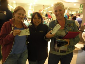 From left to right. Nola Chelin, Vannessa Gilmore and Susan Volek smiling triumphantly with their tickets in hand after having waited in line from 05:30 am. Pictures by: Nombuso Mlambo.