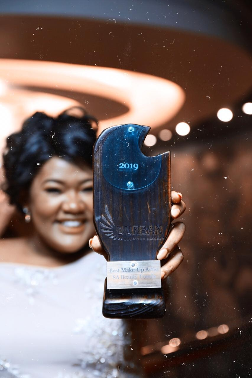 Snothile Mzimela with her award for best make up artist
