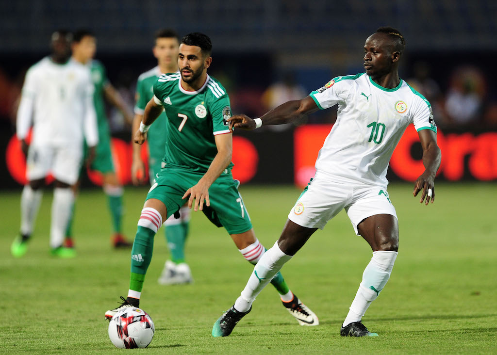 Sadio Mane of Senegal is challenged by Riyad Mahrez of Algeria during the 2019 Africa Cup of Nations Finals match between Senegal and Algeria at 30 June Stadium, Cairo, Egypt on 27 June 2019 © Ryan Wilkisky/BackpagePix