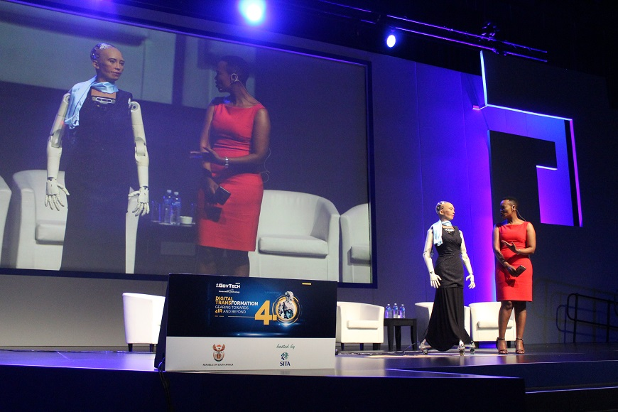 The lifelike robot engages with the Minister of Communications Stella Ndabeni-Abrahams about the Fourth Industrial Revolution (4IR) in South Africa.